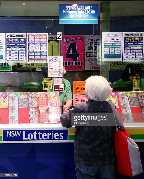 A woman buys a lottery ticket at a New South Wales Lotteries Corp retail outlet in Sydney Australia on Tuesday March 2 2010 Tatts Group Ltd...