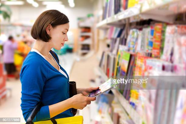woman buys a magazine - book store stock photos and pictures