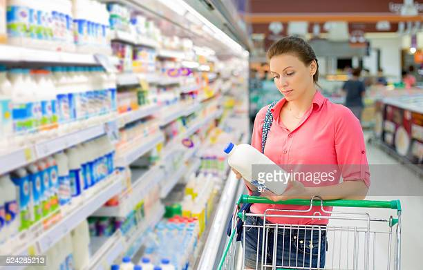 woman buys a milk - labeling stock pictures, royalty-free photos & images