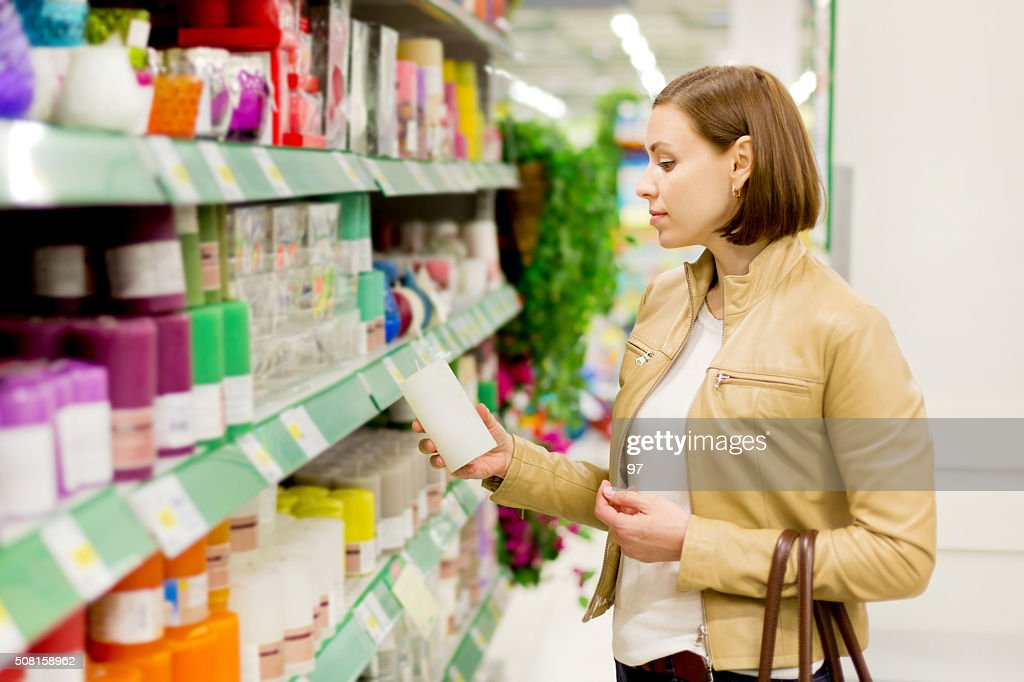 woman buys candles : Stock Photo