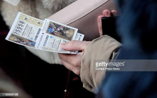 A woman buys El Niño 2020 Lottery tickets on December 23 2019 in Madrid Spain