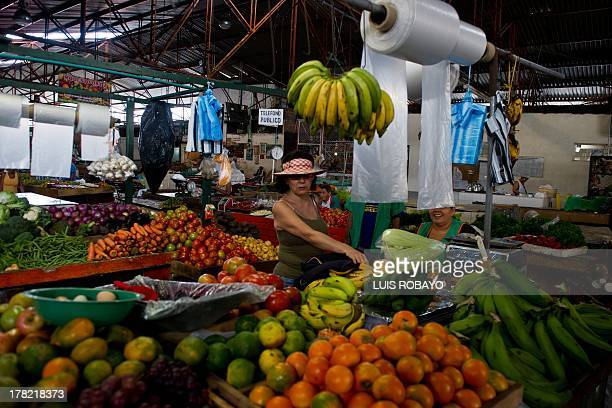 A woman buys fruits at La Alameda market in Cali department of Valle del Cauca Colombia on August 27 during the farmers strike Since the protests...