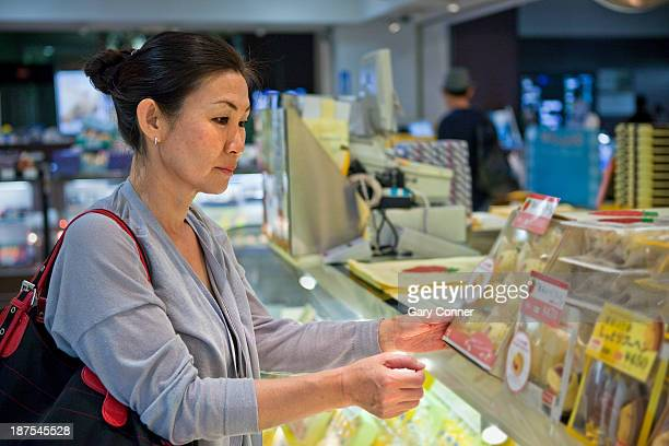 Woman buys gifts at airport shop
