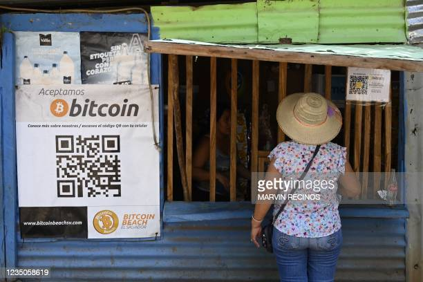Woman buys in a store that accepts bitcoins in El Zonte, La Libertad, El Salvador on September 4, 2021. - The Congress of El Salvador approved in...