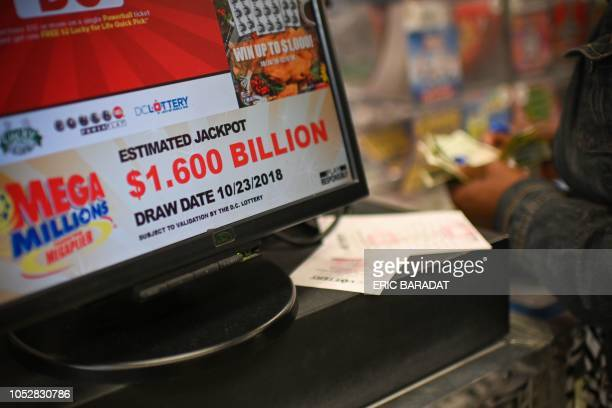 A woman buys Mega Millions tickets hours before the draw of the $16 billion jackpot at a liquor store in Downtown Washington DC on October 23 2018...