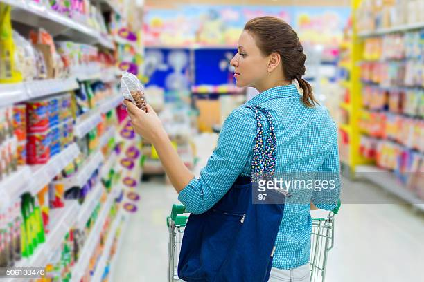 woman buys nuts in the supermarket