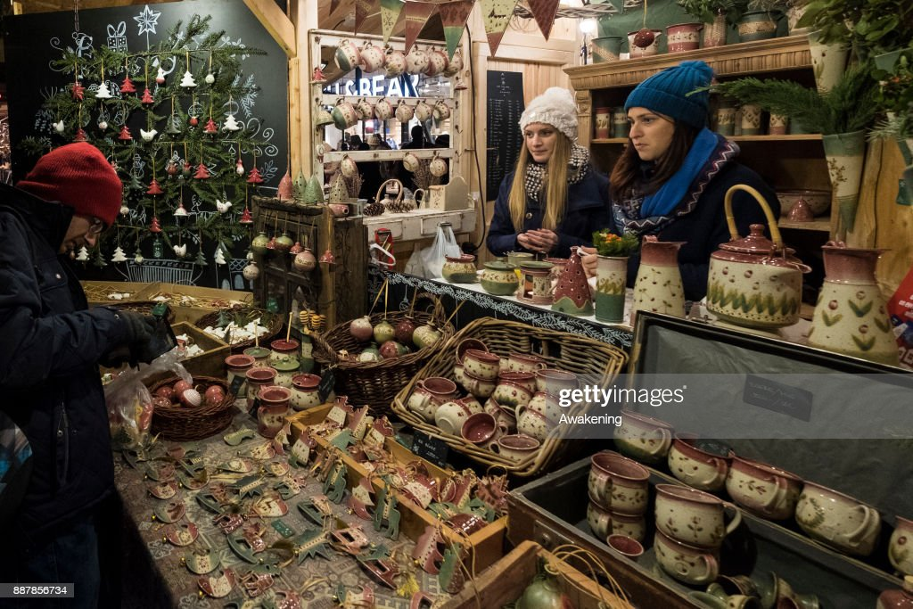 A woman buys some traditional Hungarian pottery at the Vorosmarty Square Christmas market on December 7, 2017 in Budapest, Hungary. The traditional Christmas market and lights will stay until 31st December 2017.