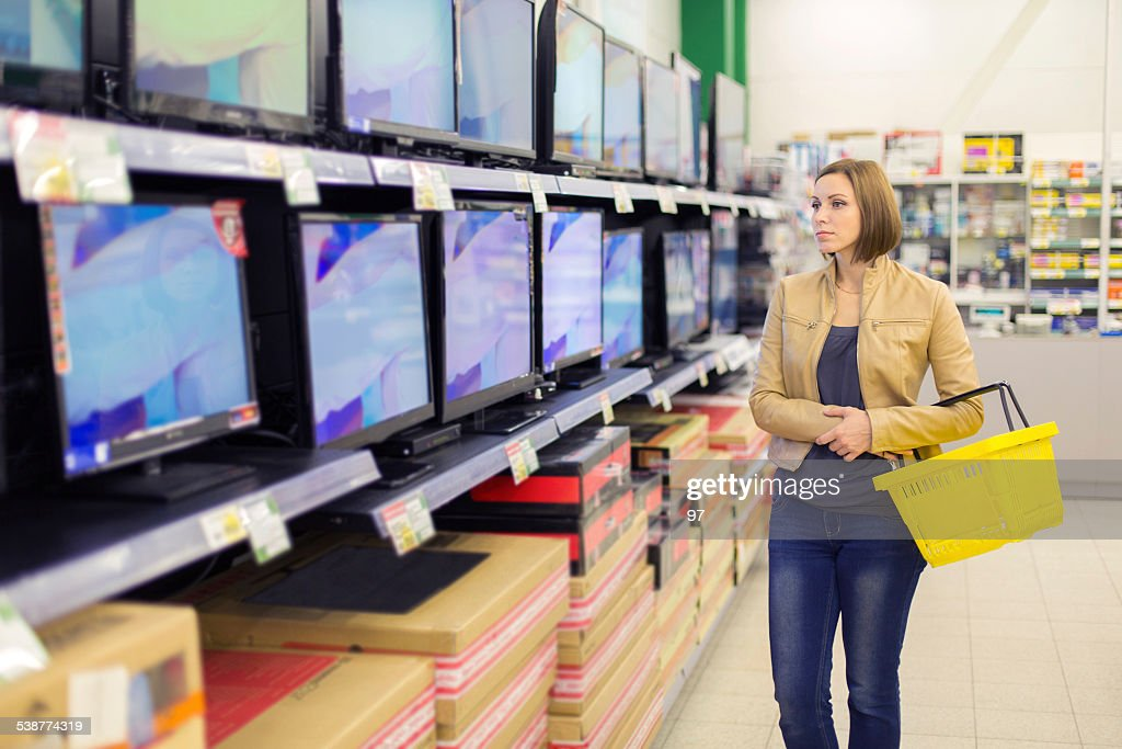 woman buys the TV : Stock Photo