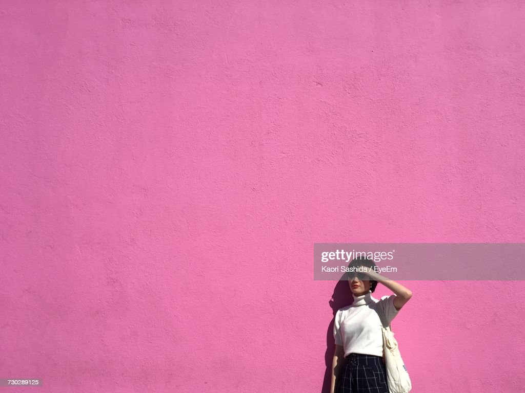 Woman By A Pink Wall : Stock Photo