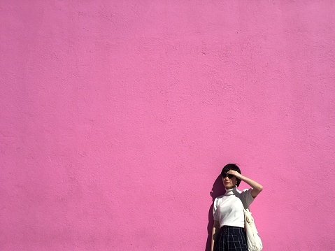 Woman By A Pink Wall - gettyimageskorea