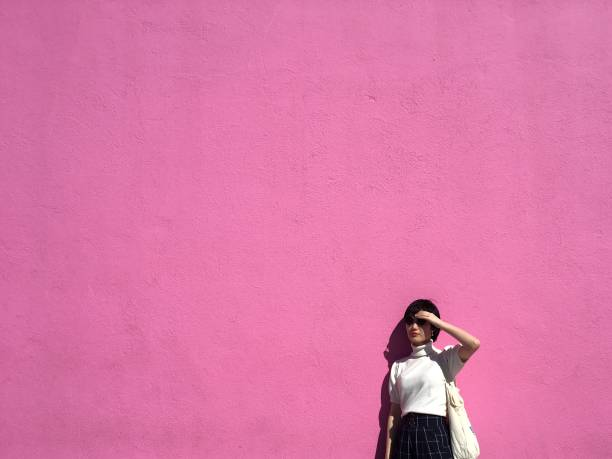 Woman By A Pink Wall
