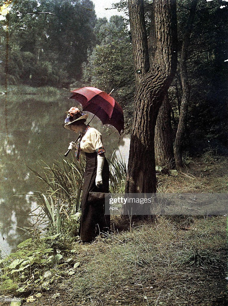 woman by a pond, Autochrome picture taken in 1906-1912