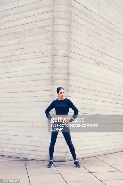 woman by building with hands on hips - legs apart stock pictures, royalty-free photos & images