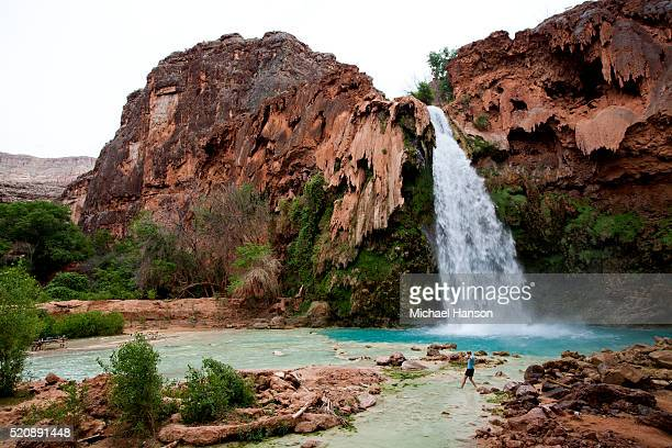 Woman by Havasupai Falls on cloudy day near Grand Canyon National Park, Arizona, USA