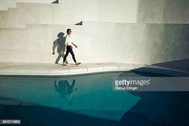 Woman by modern pool