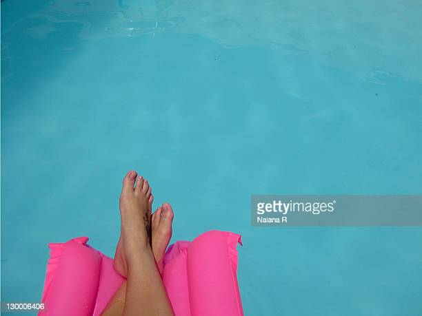 Woman by poolside