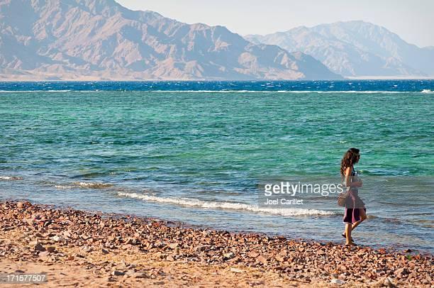 Woman by the Gulf of Aqaba in Dahab, Egypt
