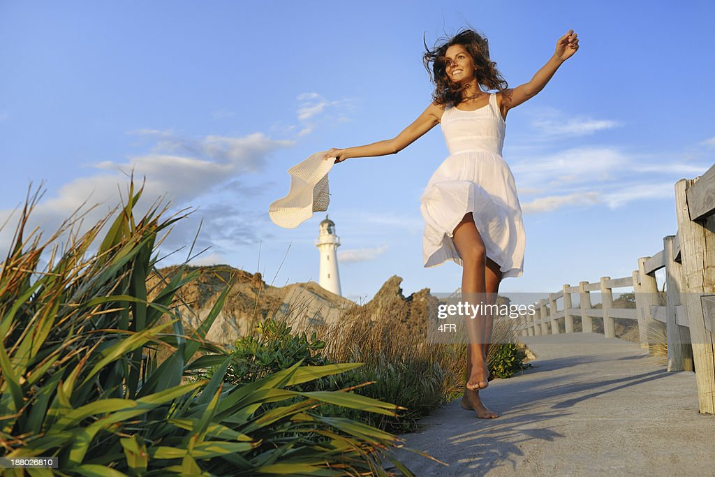 Woman by the Lighthouse, New Zealand : Stock Photo