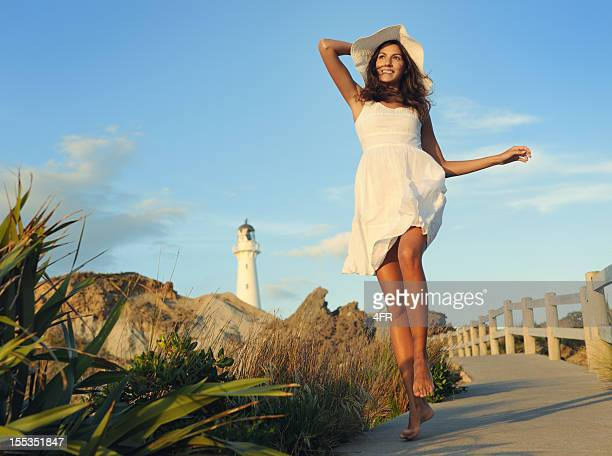 woman by the lighthouse (xxxl) - skipping along stock pictures, royalty-free photos & images