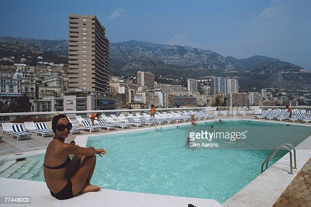 A woman by the pool on the roof of the Loews Hotel Monte Carlo Monaco August 1975