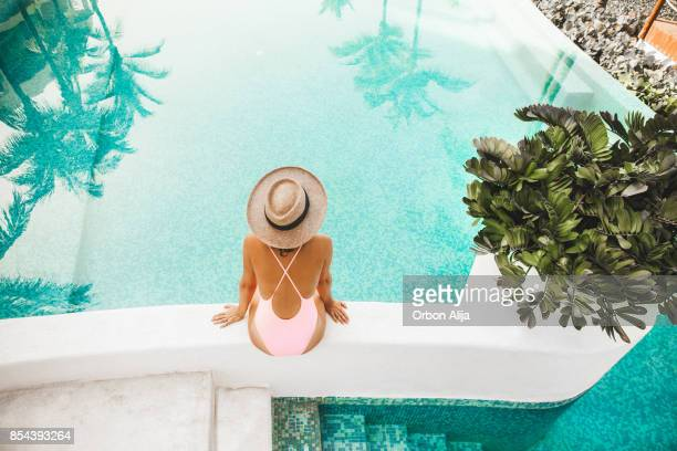 woman by the pool - tourist resort stock pictures, royalty-free photos & images
