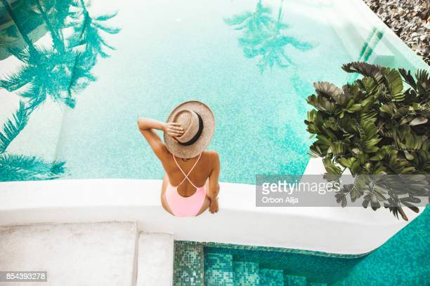 woman by the pool - greece stock pictures, royalty-free photos & images