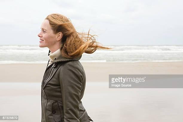 woman by the sea - coat stock-fotos und bilder