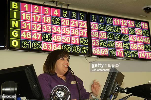 A woman caller at bingo in Plaza Hotel Casino