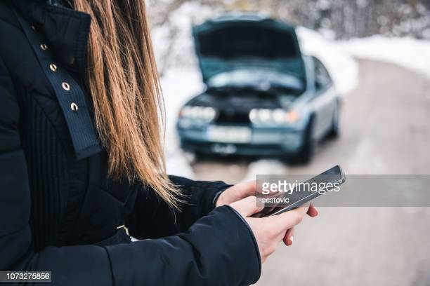 woman calling for help, her car broke! - car accident stock pictures, royalty-free photos & images
