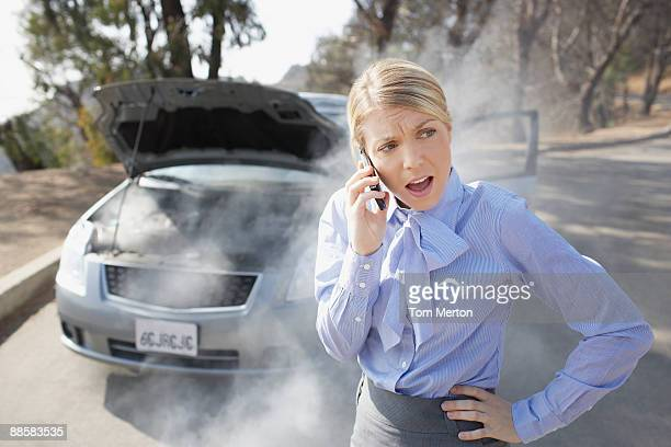 Woman calling for roadside assistance