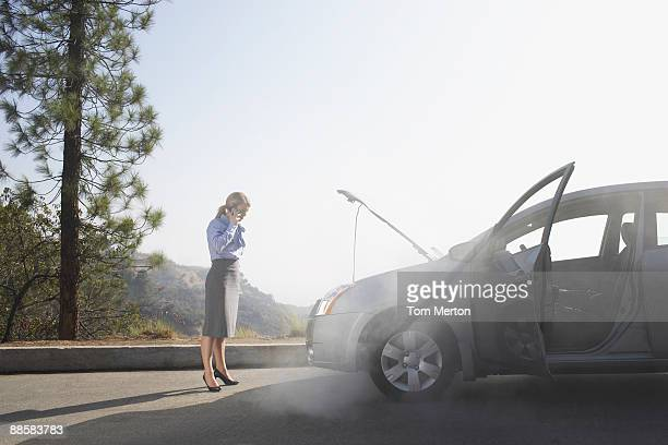 woman calling for roadside assistance - roadside stock pictures, royalty-free photos & images