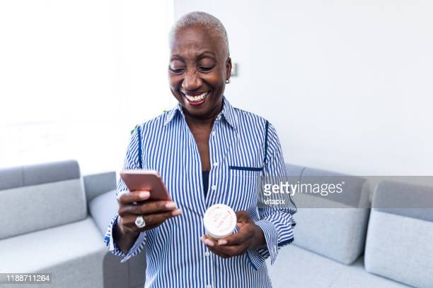 woman calling her pharmacist - prescription medicine stock pictures, royalty-free photos & images
