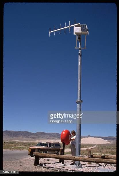 Woman Calling on Solar Powered Telephone