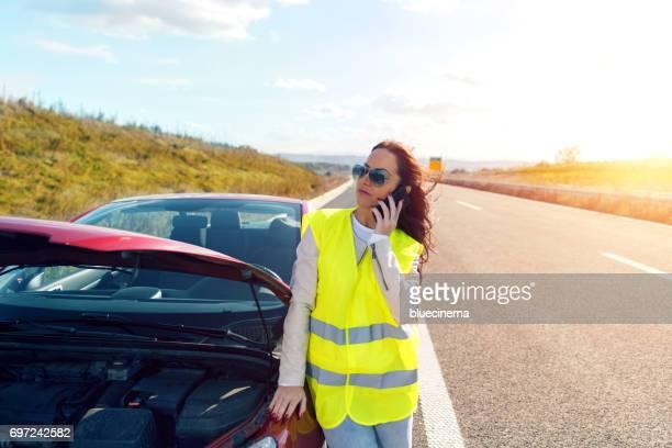 Woman calling the roadside service