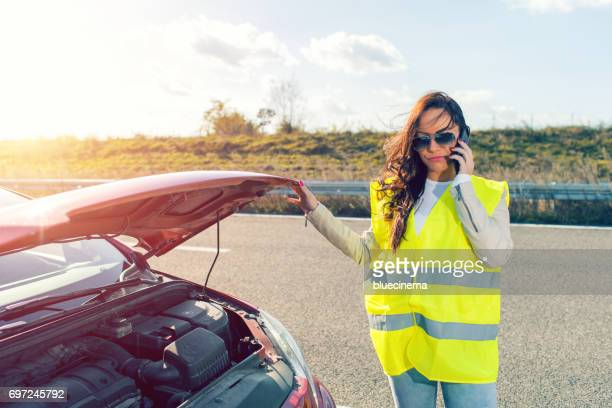 Woman calling the roadside service