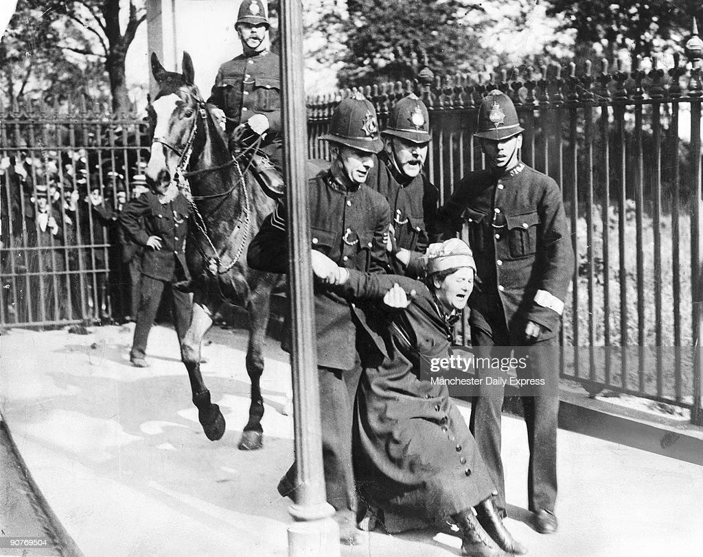 A woman campaigning for the vote is restrained by policemen. British women did not win full voting rights until 1928.