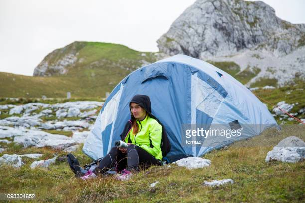 woman camping in mountains - man made structure stock pictures, royalty-free photos & images