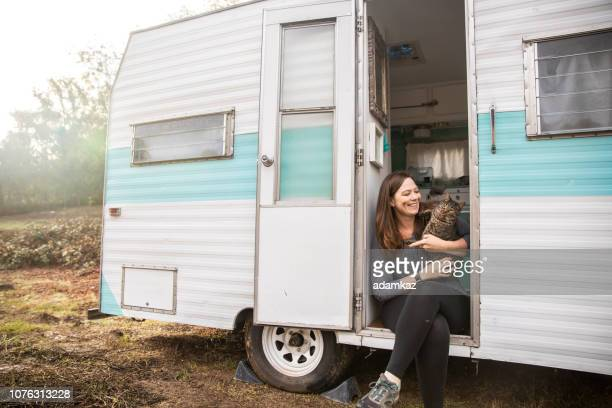 Woman Camping in Trailer with her Cat