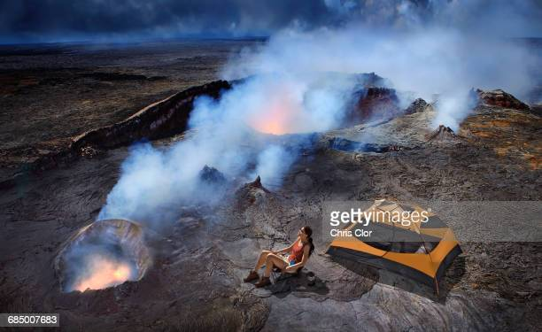 Woman camping with tent on volcano