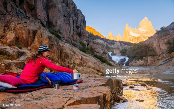 a woman camps out at fitz roy cascades near mount fitz roy - los glaciares national park stock pictures, royalty-free photos & images