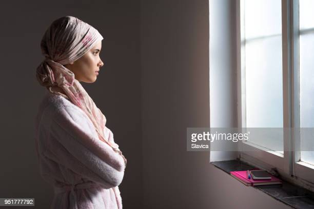 woman cancer patient in the hospital - bald woman stock photos and pictures