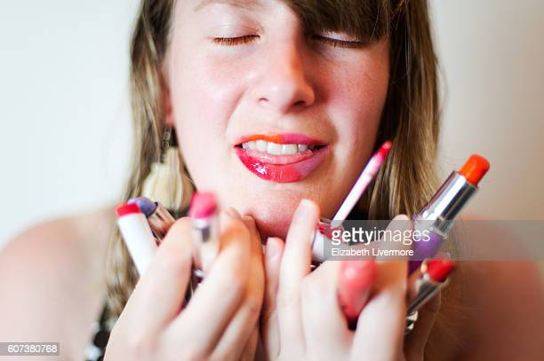 Woman cannot decide which lipstick to wear