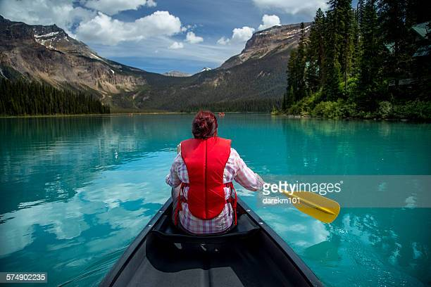 Woman canoeing in Emerald Lake, Yoho National Park, British Columbia Canada