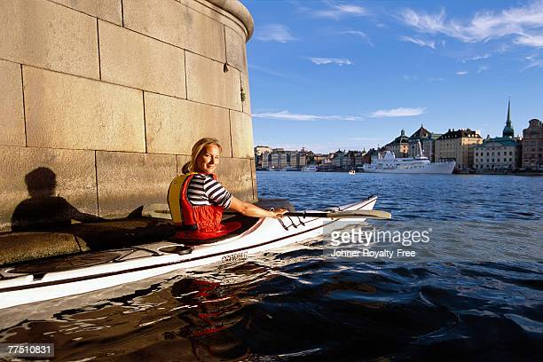 Woman canoeing in Stockholm Sweden.