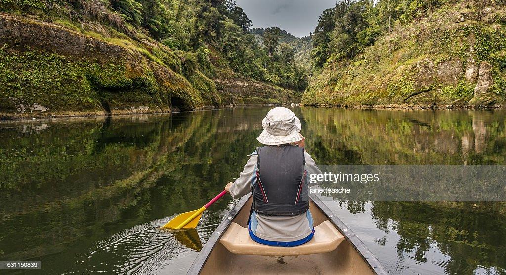 Woman canoeing on river Whanganui, North Island, New Zealand : Stock Photo