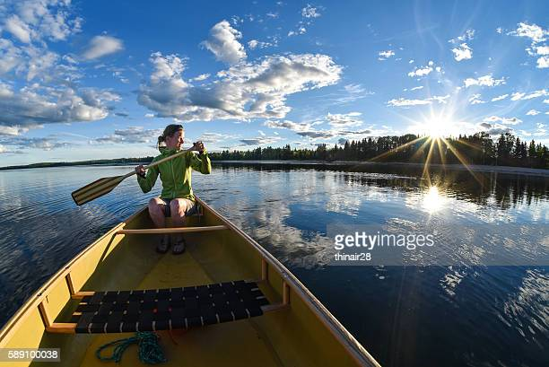 woman canoeing - saskatchewan stock pictures, royalty-free photos & images