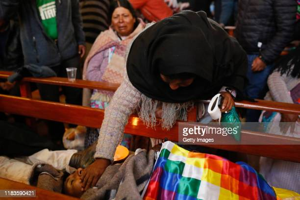 A woman caresses the body of one of the men killed yesterday during clashes between supporters of Evo Morales and security forces in the entrance of...