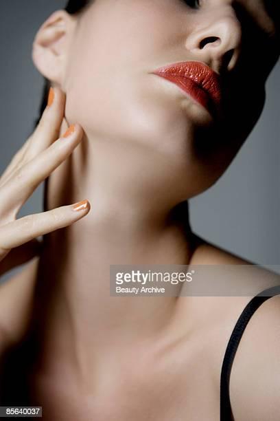 Woman caressing neck