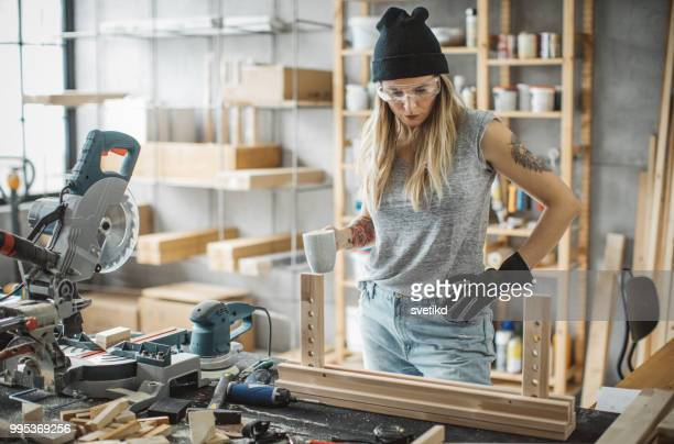 woman carpenter in workshop - work glove stock photos and pictures