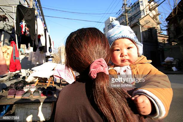 Woman carries a baby on January 10, 2009 in Shanghai, China.